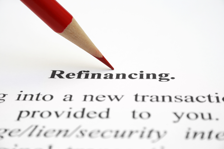 Refinancing typed out in bold on a piece of paper